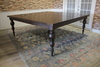 "84"" x 84"" dining table that seats 12 people. Tobacco Finish. Pictured with Bailey Turned Legs"
