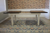 Expandable Farmhouse Table with Tobacco Finish Top and Ivory Painted Base.