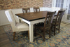 Expandable Farmhouse Table with Tobacco Finish Top and Ivory Painted Base. Also pictured William Dining Chair in Tobacco Finish and the Lauren Tufted Linen Chair in Off White Linen