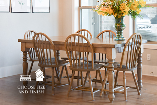 "6' L x 37"" W x 30"" H Country French Turned Leg Table with a Harvest Wheat Finish jointed top with epoxy filled top knots. Also featured our Farmhouse Spindle Back Dining Chairs."