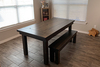 """6' L x 37"""" W Farmhouse Table - Hardwood, Boarded Look with Endcaps Top Style, Open / Natural Knots, and Deep Grey Finish. Also pictured a Custom Hardwood Farmhouse Bench for 6' Table with Top knots left open and natural in Deep Grey Finish."""