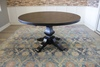 """54"""" Round Pedestal Table with Natural Open Knots in Charred Ember Finish."""