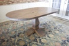 """6' L x 38"""" W Oval Heirloom Pedestal Table with Top Knots Filled in Barn Wood Finish."""