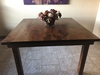 """60"""" x 60"""" x 36"""" H Square Farmhouse Table with a jointed top, filled top knots, and boarded look - grooved top in Tuscany Finish."""