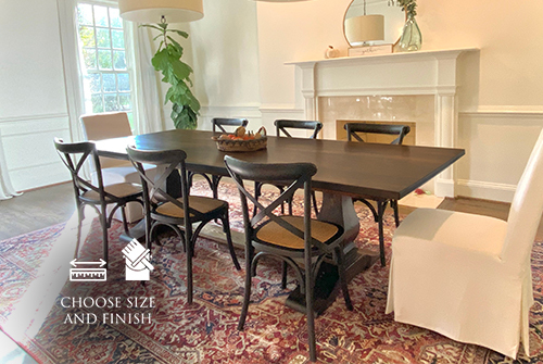 """9"""" x 45"""" Heirloom Pedestal Table in Tobacco Finish with a Jointed smooth top and Top Knots Filled. Also featured our French X-Back Chair in Distressed Charcoal."""