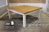 Square Farmhouse Dining Table, Top Style  Boarded Look with Endcaps, Natural / Open Knots in Harvest Wheat Finish. Base in custom distressed Ivory.