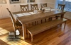 """8' L x 45"""" W Farmhouse Table, Jointed Top in Harvest Wheat Finish with Knots on Top of Table Filled With Clear Epoxy. Also pictured our Double X Back Dining Chairs in Harvest Wheat Finish and the Annli Bench with Knots on Top of Bench Filled With Clear Epoxy in Harvest Wheat Finish"""