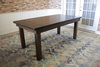 Farmhouse Table - Hardwood in Tobacco Finish with Boarded Look / Grooved top with Endcaps and Tobacco Finish base.