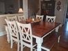 """66"""" Square Baluster Table upgraded to Knotty Alder hardwood top in Tuscany finish and ivory painted base. Jointed with filled knots. Pictured with our Dianne Bench upgraded to Knotty Alder top in Tuscany finish with Ivory painted base and Double X-Back Dining Chair."""