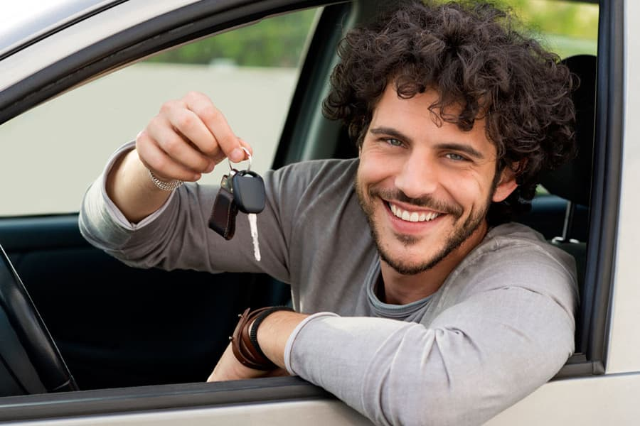 Man Smiling Holds Key