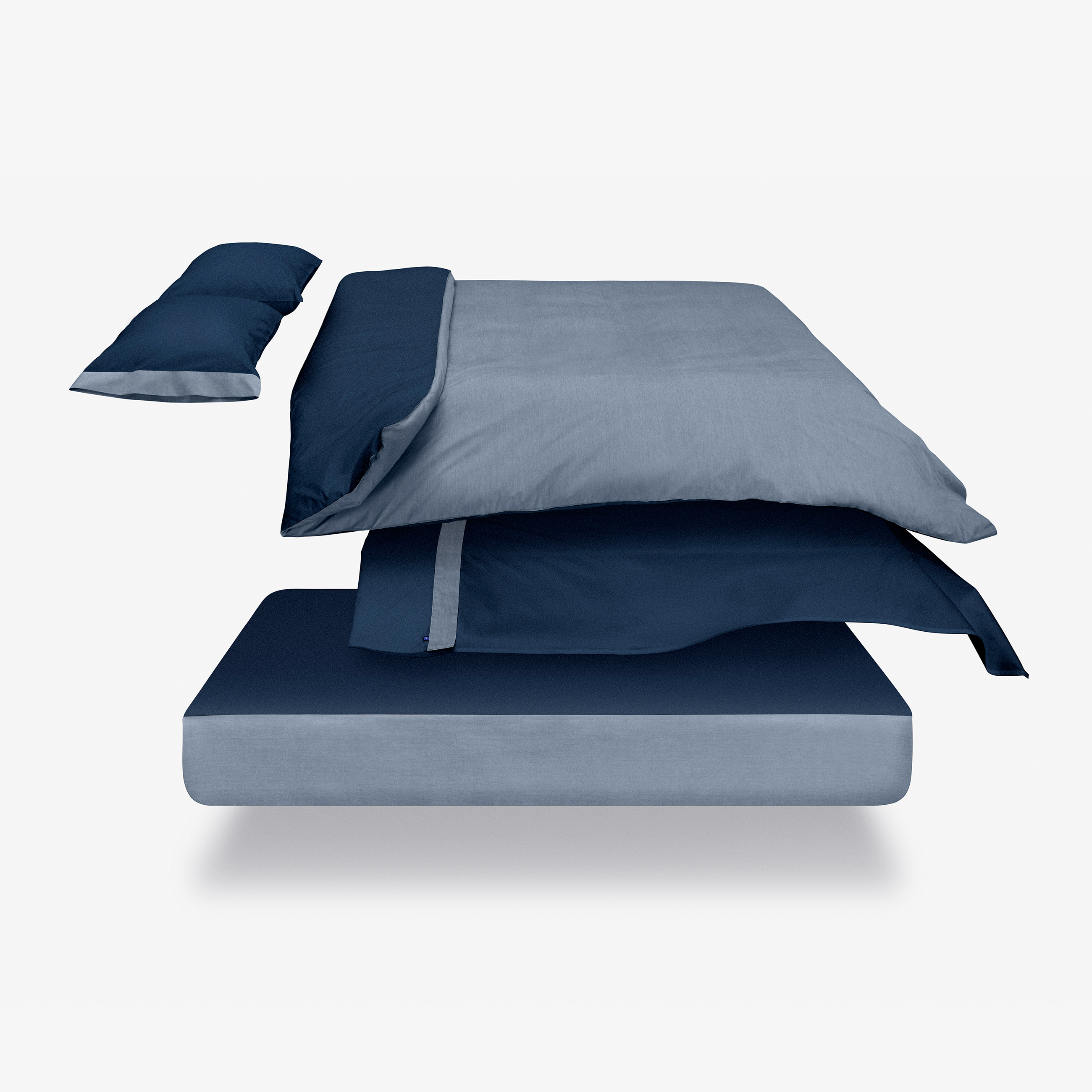 Premium Cotton Percale Duvet by Casper -  Full/Queen - Navy/Azure The Casper Full/Queen Navy/Azure duvet cover is made rom 100% extra-long staple Supima cotton.   We've found the ideal thread count to balance softness, strength, and breathability, so our percale weave is more breathable and longer lasting than other popular weaves. Plus, hidden openings offer easy access to the securing snaps in each corner. Try it for 100 nights, risk-free.