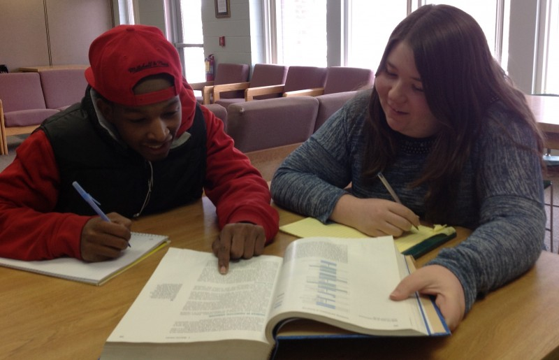 A tutor works with a student.