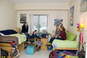 Students relaxing in a dorm room.