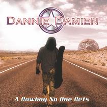 A Cowboy No One Gets by Dannie Damien
