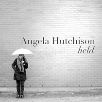 Held by Angela Hutchison