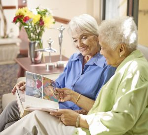 St. Joseph Assisted Living Facility Two Women Sharing Photobook