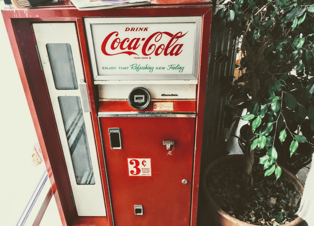photo of an cold coca-cola vending machine