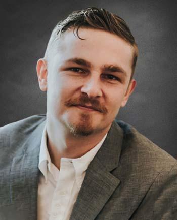 Headshot of Ryan McDaniel
