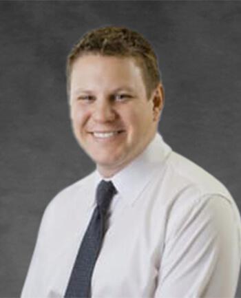 Headshot of Adam  Dell