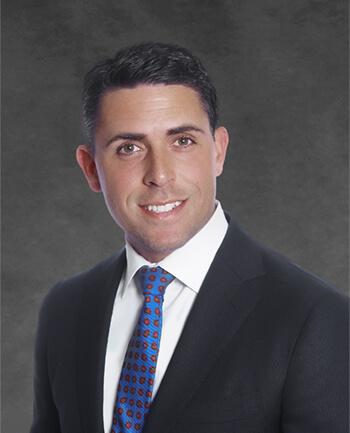 Headshot of Daniel  Holton