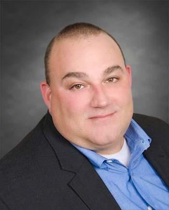 Headshot of Peter Orsita