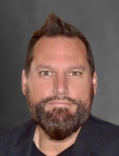 Headshot of Greg Tracy