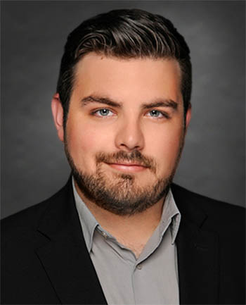 Headshot of Andrew Acosta