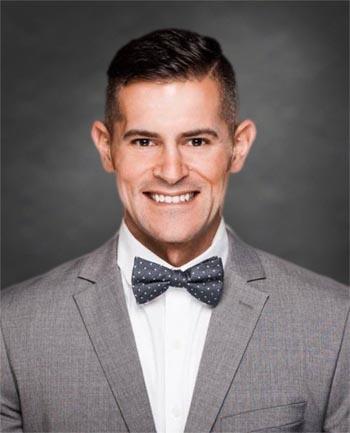 Headshot of Christopher Kouvatsos