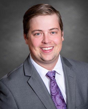 Headshot of Adam Macho
