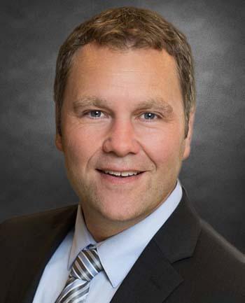 Headshot of Brett Leschinsky