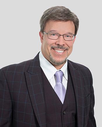 Headshot of George Koutsos, CMA