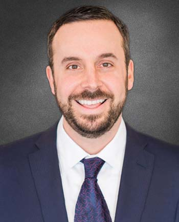 Headshot of Andrew Marquis