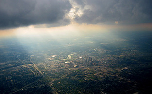 Sidebar_city-from-plane-with-clouds-500-cc-blake-facey