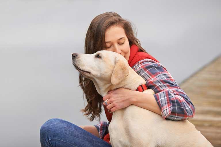owner embracing dog