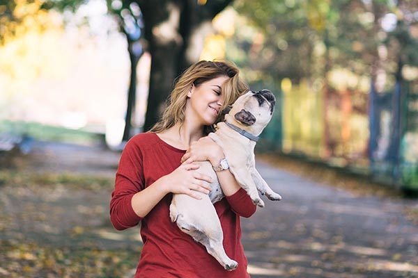 french-bulldog-woman-holding-outside-body