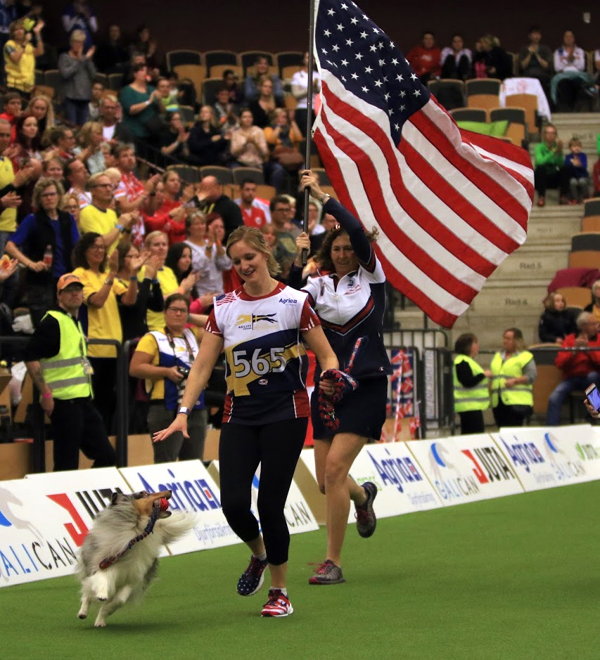 Jennifer Crank celebrates with her dog, Swift, after winning a silver medal at the 2018 FCI World Agility Championship. The duo represented the U.S. and AKC.