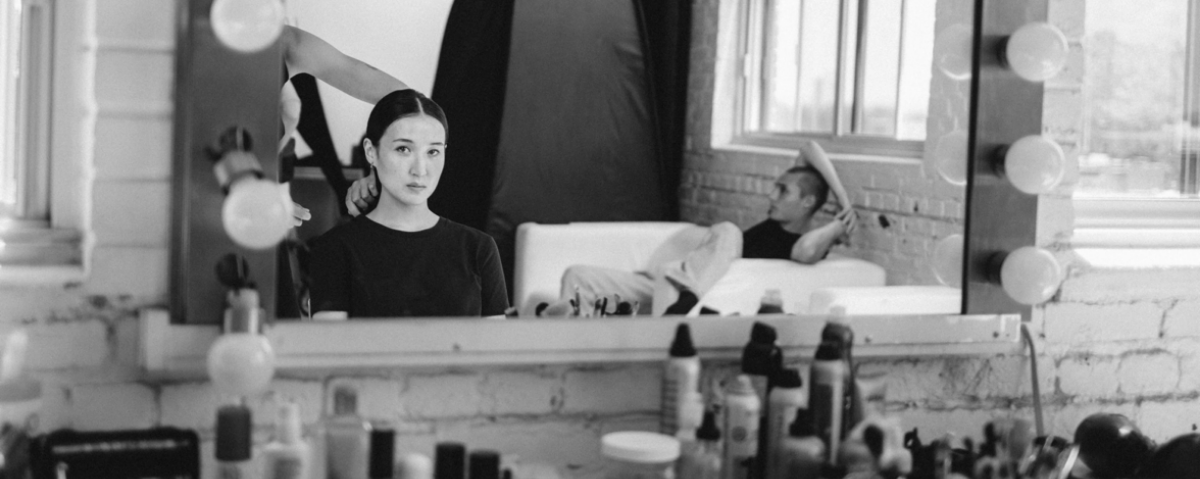 A brief moment of self-reflection. Jade [@lu.cha.biao] in the makeup chair, Eric [@eric._.caldwell] leaning back on the sofa.