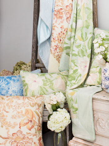 display of velvet cushions and throws