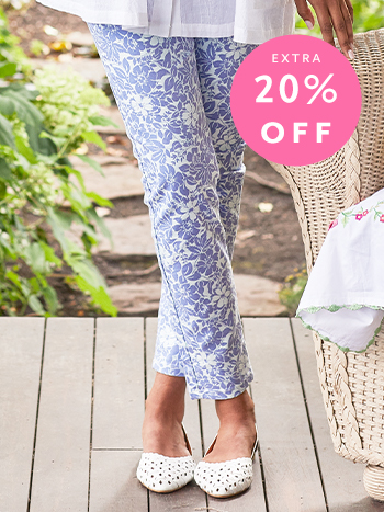 Womans legs wearing printed periwinkle pants.
