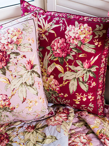 Two Hydrangea Dream Cushions in Amethyst and Cranberry.