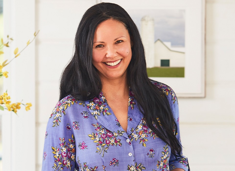 Woman wearing the Bellevue Cottage Blouse in Periwinkle.