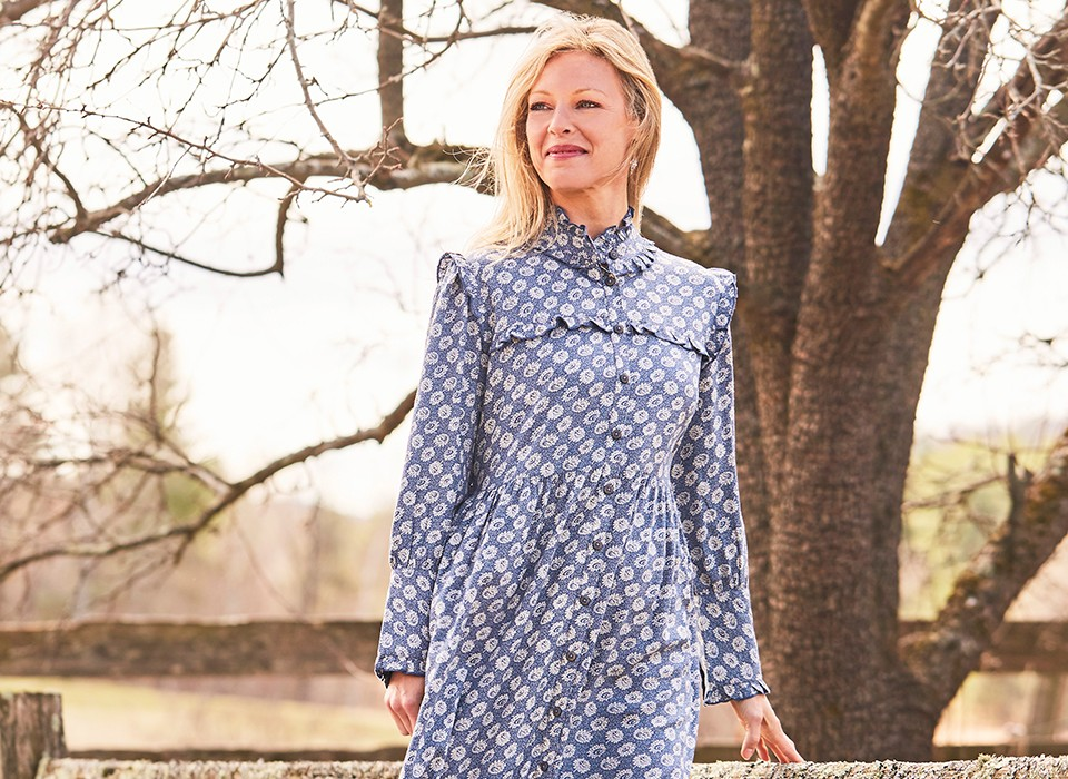 Woman wearing the Gwennie Old Soul Dress in Tapestry Blue.