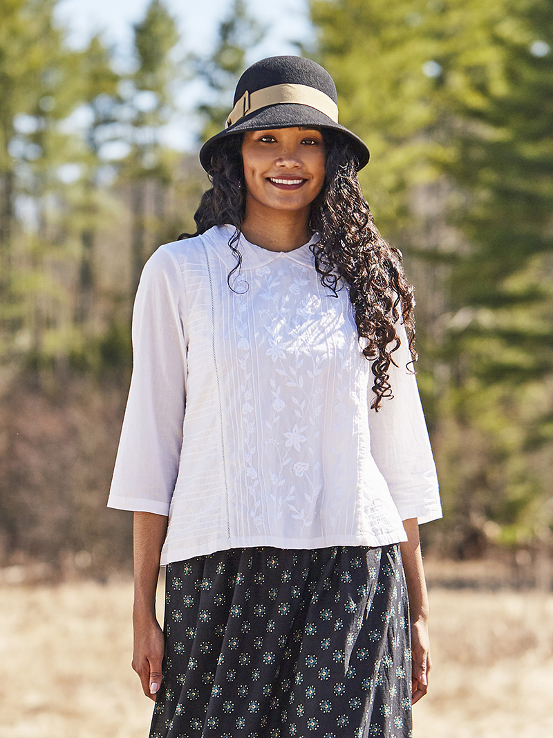 Woman wearing the Christina Blouse in White.