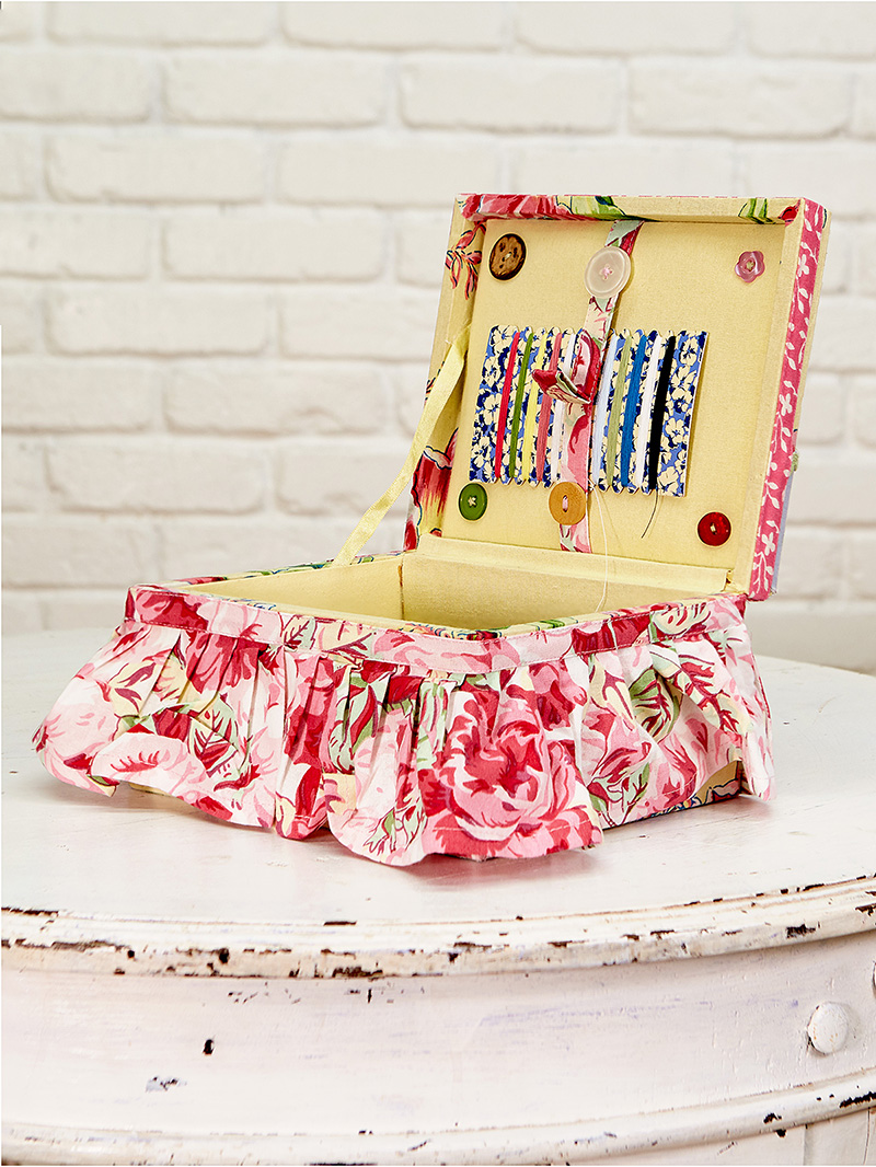 Open sewing box with accessories.