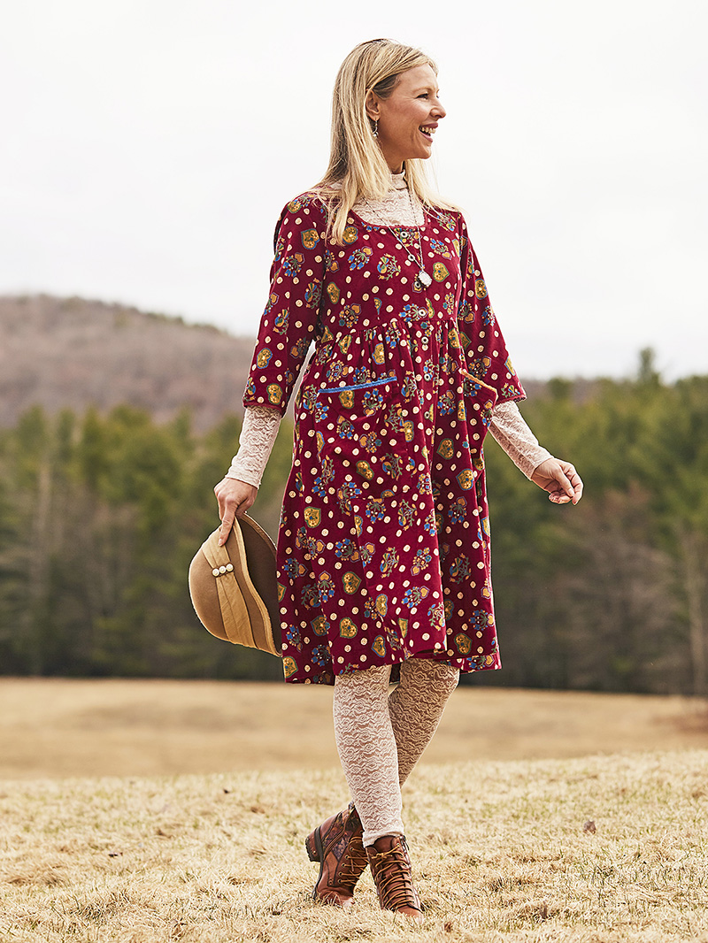 Woman wearing the Folklore Dress in Vintage Red.