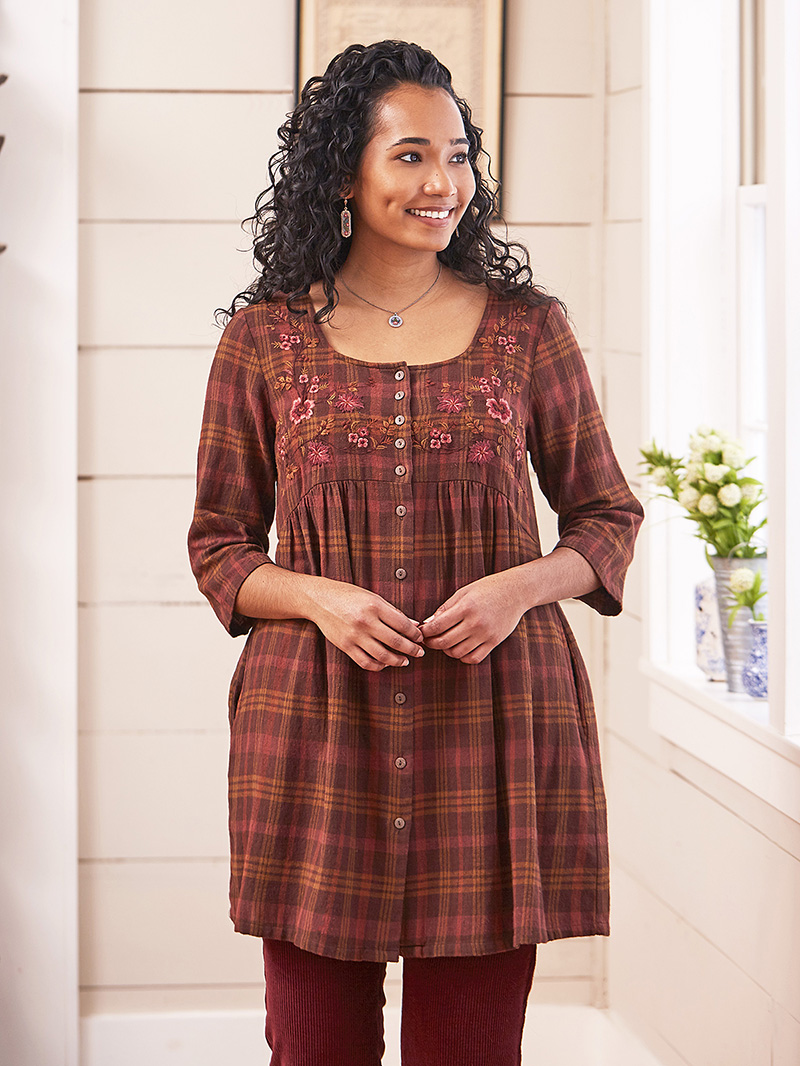 Woman wearing the Timber Plaid Tunic Dress in Brown.