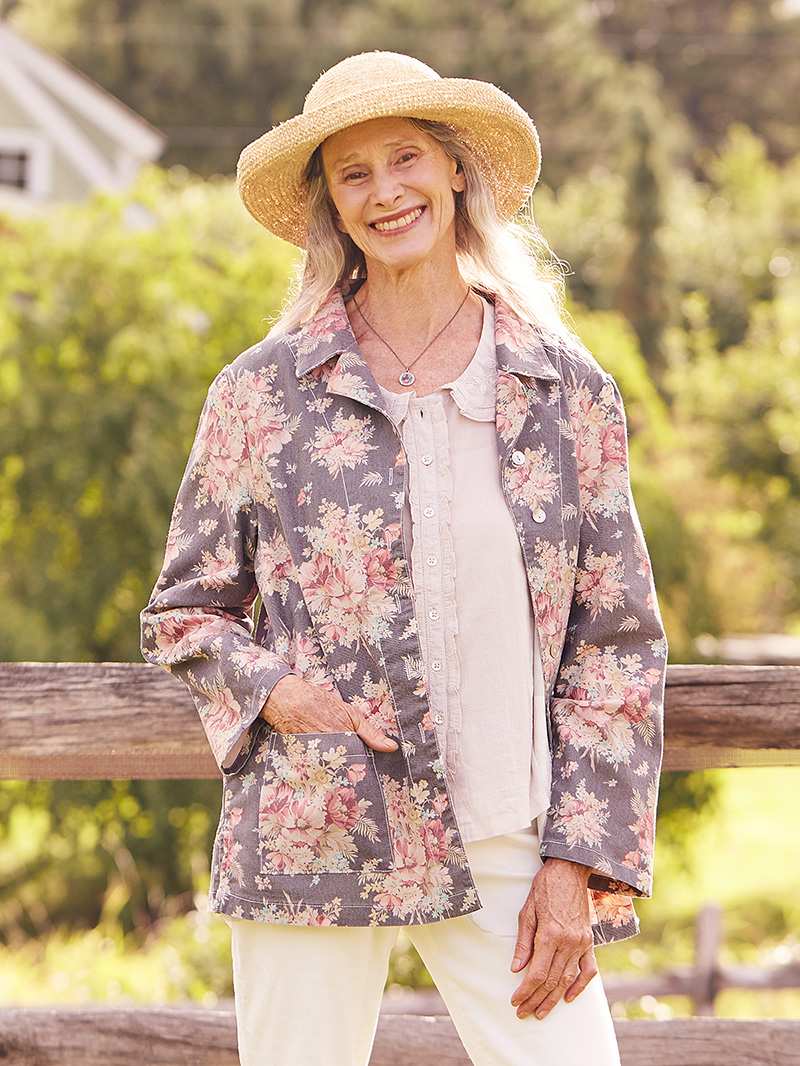 Woman wearing the Ellie Cottage Jacket in Charcoal.
