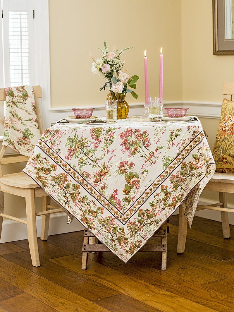Meadow Walk Tablecloth draped neatly over a table.