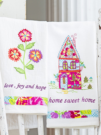 A set of colorful, embroidered tea towels.