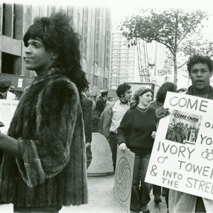 Marsha P. Johnson hands out flyers for support of gay students at N.Y.U., 1970. Source: New York Public Library Digital Collections